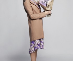 Fashionable woman receiving flowers Stock Photo 03