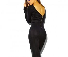 Fashionable woman wearing black backless long skirt Stock Photo
