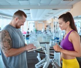 Fitness coach formulate fitness program Stock Photo