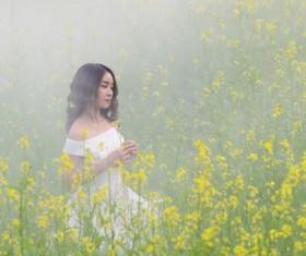 Girl standing in rape blossoms Stock Photo