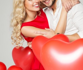 Happy couple and heart balloons Stock Photo 02
