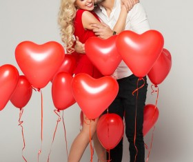 Happy couple and heart balloons Stock Photo 03
