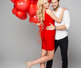Happy couple and heart balloons Stock Photo 05