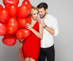 Happy couple and heart balloons Stock Photo 08
