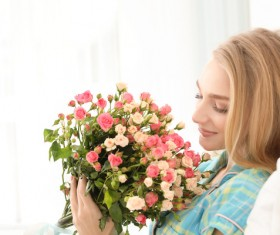 Happy girl holding a bouquet of roses Stock Photo 01