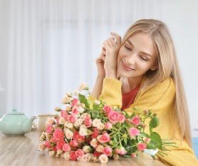 Happy girl holding a bouquet of roses Stock Photo 03