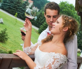Happy wedding couple drinking wine Stock Photo