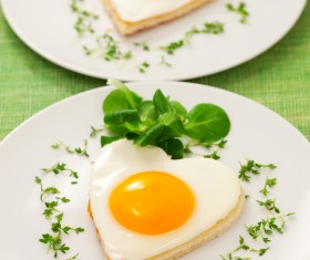 Heart-shaped fried egg and bread breakfast Stock Photo 01