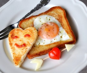 Heart-shaped fried egg and bread breakfast Stock Photo 02
