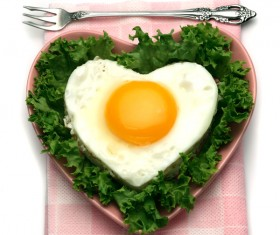 Heart-shaped fried egg and bread breakfast Stock Photo 03