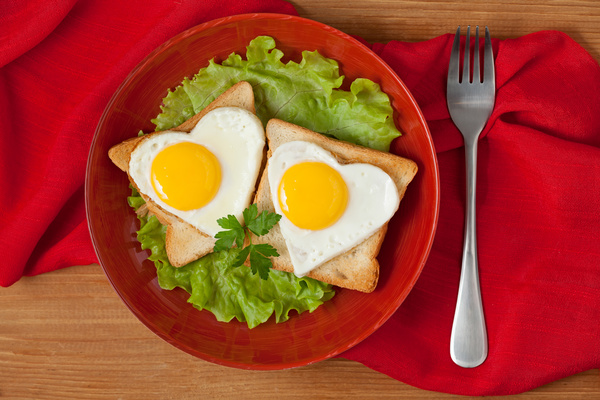 Heart-shaped fried egg and bread breakfast Stock Photo 04