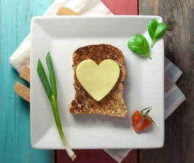 Heart-shaped fried egg and bread breakfast Stock Photo 05