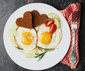 Heart-shaped fried egg and bread breakfast Stock Photo 07