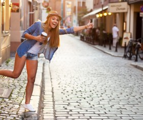 Hold instant coffee girl hail a taxi Stock Photo