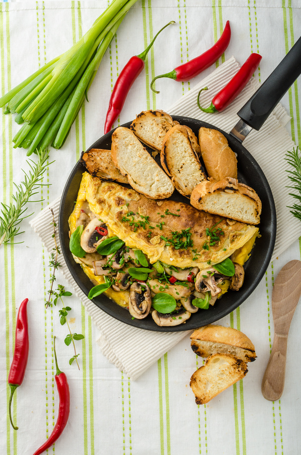 Home cooking mushrooms omelet and slice of bread Stock Photo