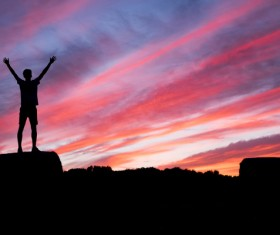 In the sunset open arms man Stock Photo