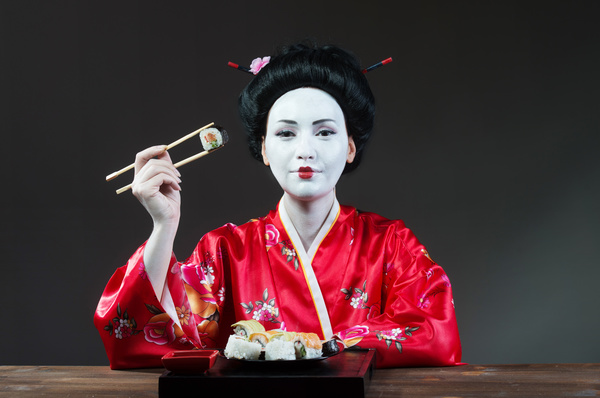 Japanese girl eating sushi Stock Photo 01
