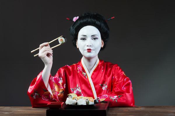 Japanese girl eating sushi Stock Photo 01