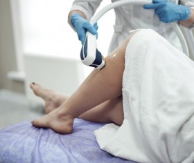 Laser hair removal for womens legs Stock Photo