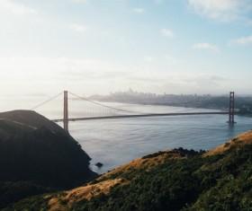 Long bridge structure on calm sea Stock Photo