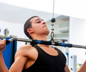 Man exercising back muscles in gym Stock Photo