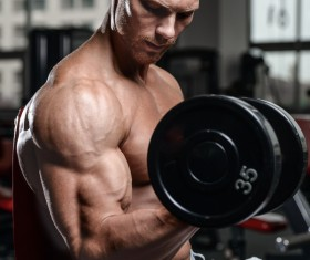 Man exercising biceps Stock Photo 01