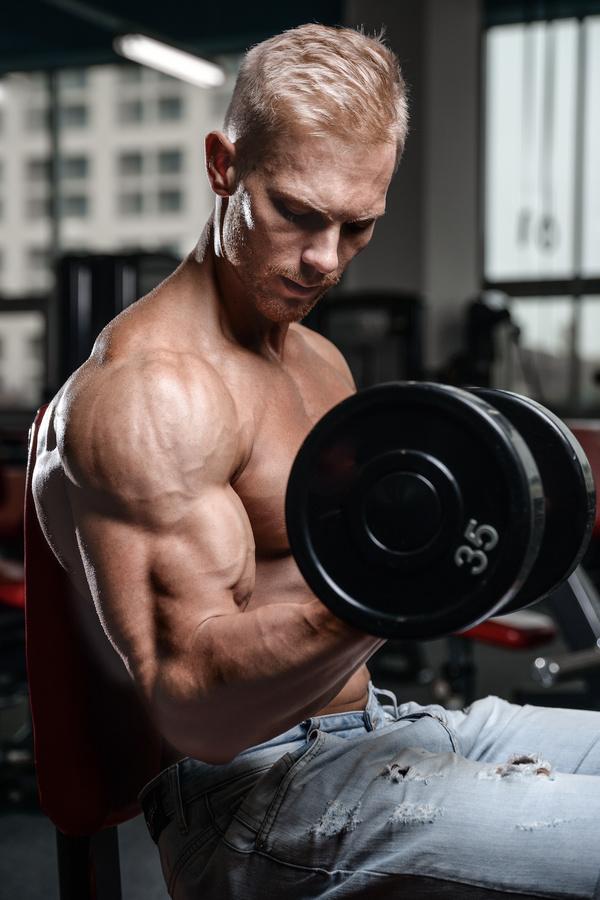Man exercising biceps Stock Photo 01