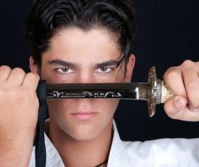 Man holding samurai sword Stock Photo
