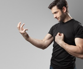 Man looking at his arm Stock Photo