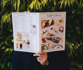 Man looking menu Stock Photo