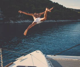Man playing diving on the yacht Stock Photo