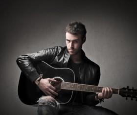 Man playing the guitar Stock Photo 01