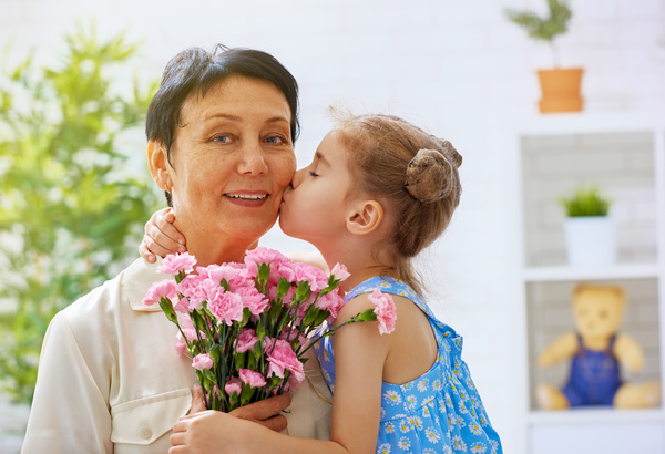 Mothers Day gave grandmas flowers Stock Photo 01
