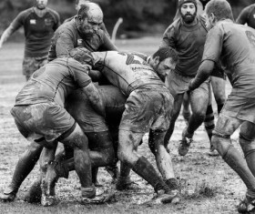 Muddy rugby match Stock Photo
