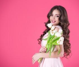 Pink dress girl holds tulip flower Stock Photo 01
