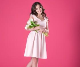 Pink dress girl holds tulip flower Stock Photo 02