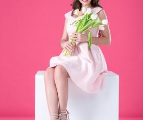 Pink dress girl holds tulip flower Stock Photo 03