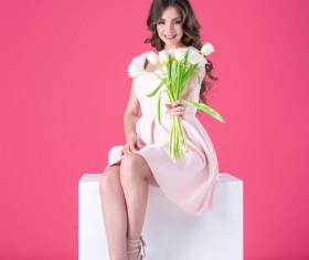 Pink dress girl holds tulip flower Stock Photo 04