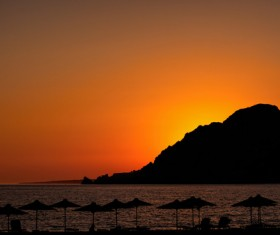 Quiet beach and sunset Stock Photo