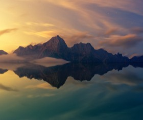 Reflection of rocky mountain on calm lake Stock Photo