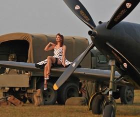 Retro woman sitting on vintage plane Stock Photo
