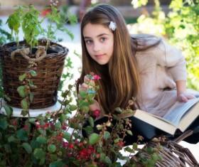 Smell flowers little girl Stock Photo