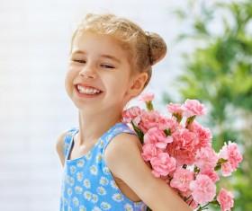 Smiling little girl holding flowers Stock Photo