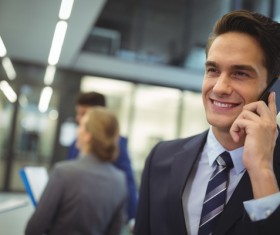 Smiling man is calling girlfriend Stock Photo