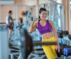 Smiling woman in the gym Stock Photo