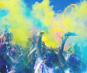 Spectators excited in color festival Stock Photo
