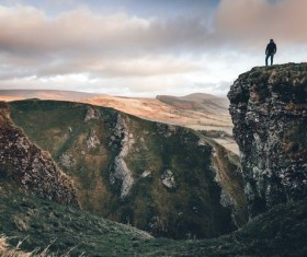 Standing in the mountains looking distant scenery man Stock Photo