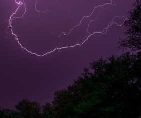 Thunderbolts on violet dark sky Stock Photo