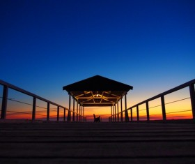 Twilight at night with wooden pier Stock Photo