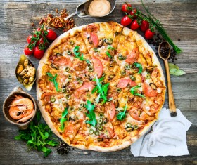 Vegetables pizza and seafood on the desktop Stock Photo
